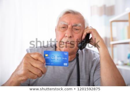 Man With Credit Card Using Landline Phone Stock photo © AndreyPopov