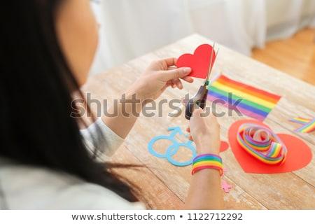 hands cutting gay awareness ribbon by scissors Stock photo © dolgachov
