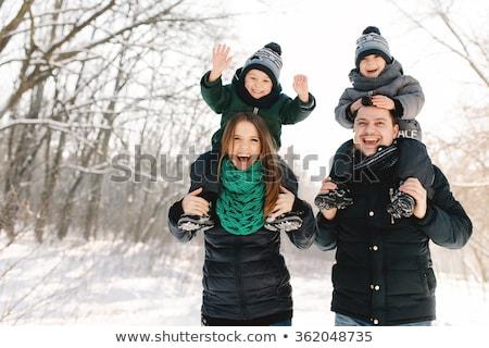 Pregnant couple have fun in winter nature Stock photo © Lopolo