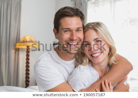 молодые любящий пару кровать руки за Сток-фото © Lopolo