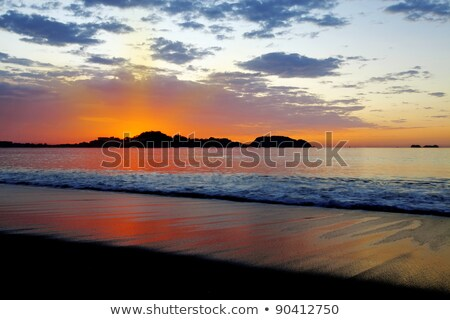 Costa Rica sunset sky. Shoreline and mountains. Stock photo © Lopolo