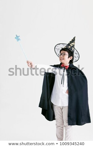 Smiling Magician Holding Magic Wand Stock photo © AndreyPopov