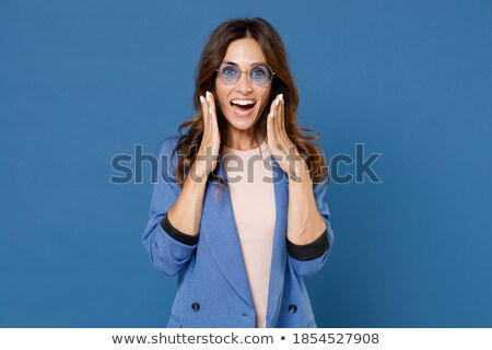 Image of surprised woman 20s wearing jacket wondering and touchi Stock photo © deandrobot