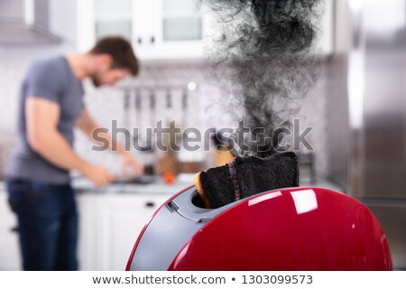 Close-up Of A Red Toaster With Burnt Toast Stock photo © AndreyPopov