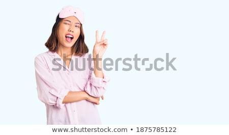 Two smiling girls wearing pajamas Stock photo © deandrobot