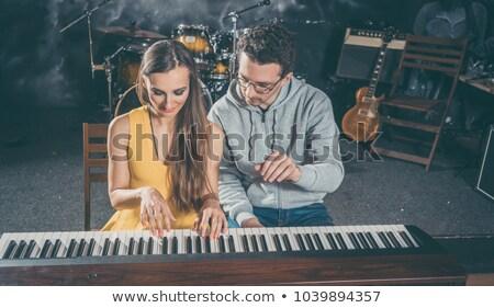 Fortepian nauczyciel muzyki lekcje student szkoły Zdjęcia stock © Kzenon