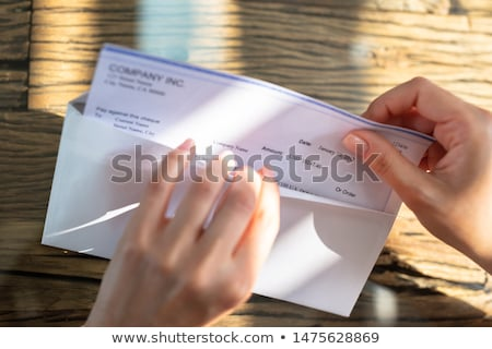 Businessperson Opening Envelope With Paycheck Stock photo © AndreyPopov