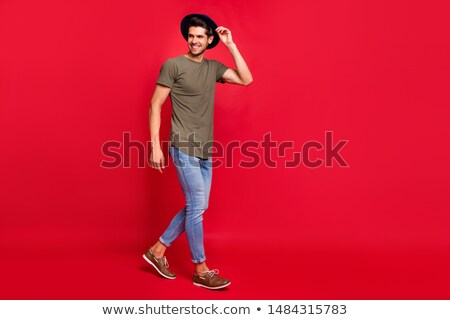 Young attractive man stepping at a side, looking at the camera Stock photo © feedough