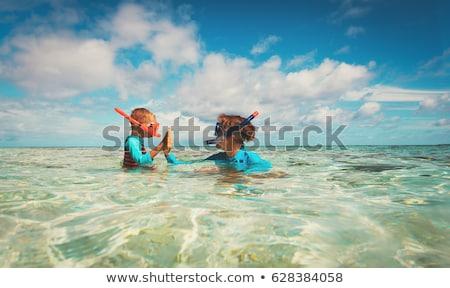 Boldog anya fiú snorkeling tengerpart nő Stock fotó © galitskaya