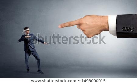Stock photo: Big hand catching small karate man