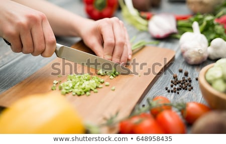 Chef cuts the vegetables into a meal. Preparing dishes. A woman uses a knife and cooks Stock photo © ruslanshramko