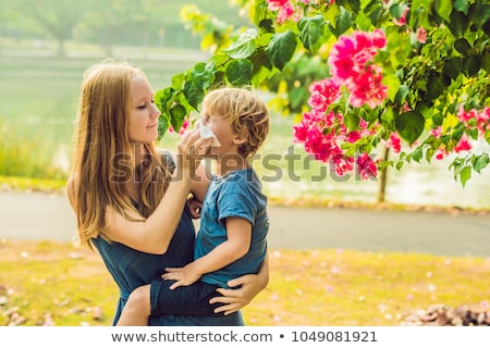 Stock fotó: Mom looks at his son who is allergic to pollen
