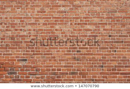 Edad rojo pared de ladrillo textura yeso construcción Foto stock © feverpitch