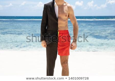 Adam şort ayakta plaj portre deniz Stok fotoğraf © AndreyPopov