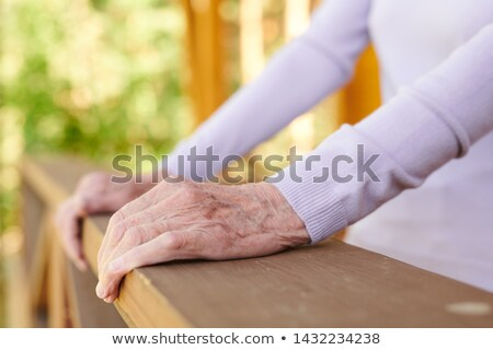 Hands of senior woman in white long-sleeved pullover Stock photo © pressmaster