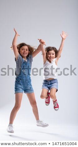 Two joyful hyperactive young sisters jumping Stock photo © Giulio_Fornasar