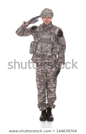 Soldier in military uniform  saluting over white background Stock photo © Lopolo