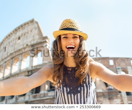 Female Tourist In Front Of Colosseum Stock photo © AndreyPopov
