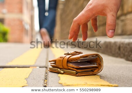Сток-фото: Person Picking Up Lost Purse