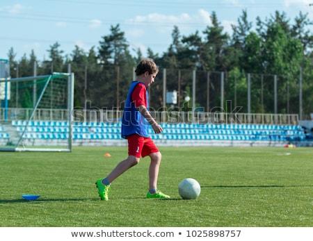 Jóképű tinédzser fiú futball játék kívül Stock fotó © Lopolo
