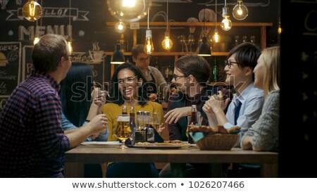 Insanlar konuşuyor bar arkadaşlar toplantı birahane adam Stok fotoğraf © robuart