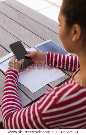 Overhead mid section view of a African American woman using a digital tablet on her terrace at home stock photo © wavebreak_media