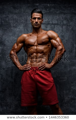 Abs of a muscular man Stock photo © stryjek