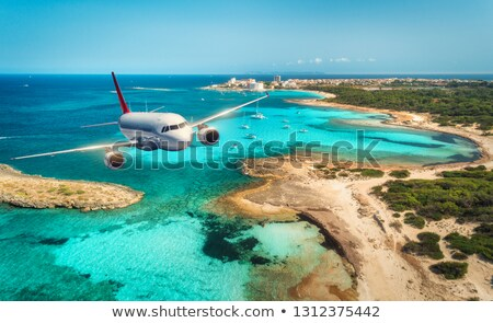 Airplane Is Flying Over Island In Summer Stock photo © AndreyPopov