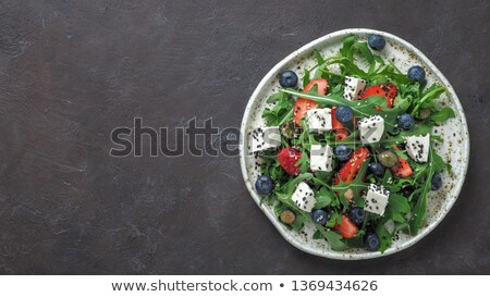 Banner of Fresh salad with arugula, strawberries, feta cheese and nuts. Stock photo © Illia