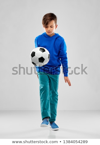 Stock photo: smiling boy in blue hoodie playing soccer ball