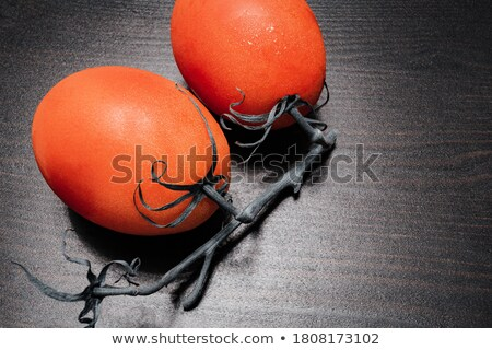 Top view of highly detailed red tomatoes on black background being wet. Juicy appetising vegetables  Stock photo © vkstudio