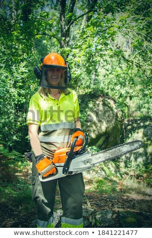 Beauty woman with chainsaw Stock photo © vladacanon