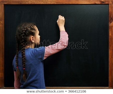Hand with piece of chalk Stock photo © leeser