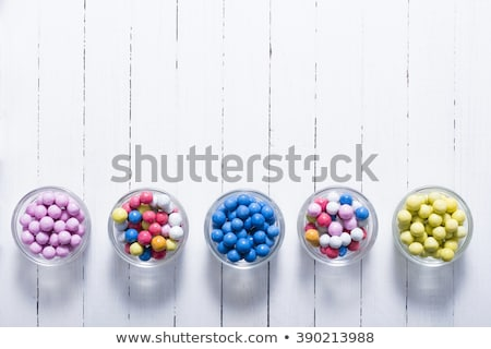 Yellow dragee pills Stock photo © simply