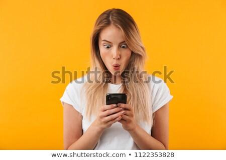 jonge · vrouw · vergadering · sofa · mobieltje · portret - stockfoto © redbaron
