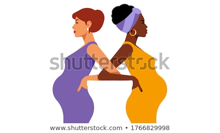 lovely pregnant woman in black working out stock photo © dolgachov