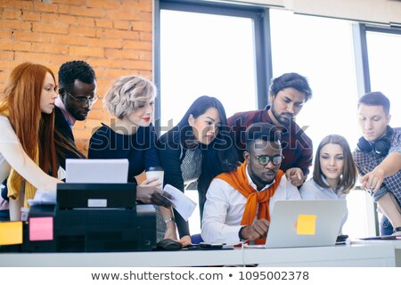 Young people gathered round a laptop Stock photo © photography33