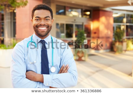 Doctor standing outside a hospital stock photo © photography33