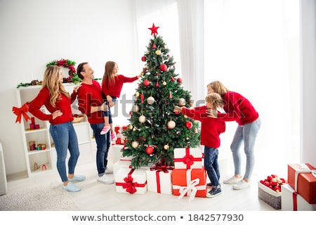 Couple gathered by Christmas tree Stock photo © photography33