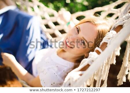 Hermosa femenino sesión hamaca sombrero de paja soleado Foto stock © dash