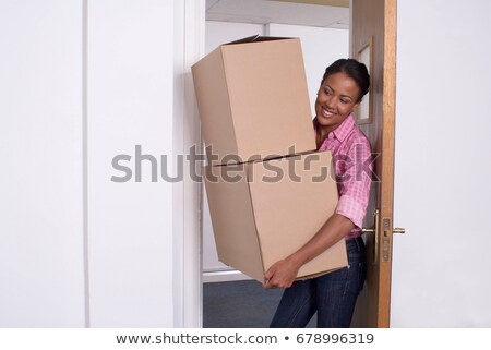 Three woman leaning on brown cardboard boxes Stock photo © photography33