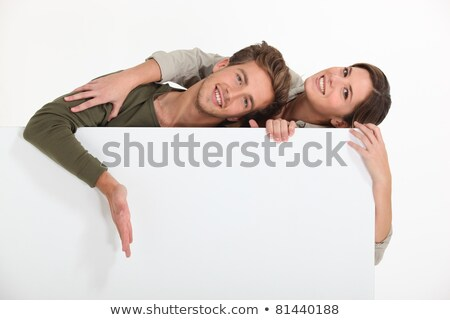 Couple stood by blank message board Stock photo © photography33