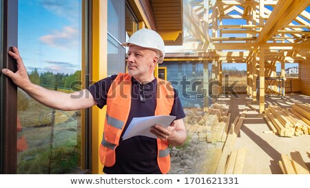 An engineer looking at a blueprint before a meeting Stock photo © photography33