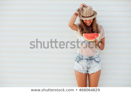 pretty girl with watermelon isolated  Stock photo © OleksandrO