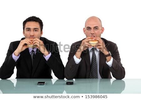 бизнесменов · еды · гамбургер · продовольствие · лице · человека - Сток-фото © photography33