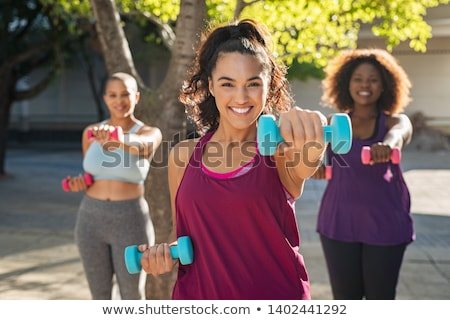 overweight woman exercising on trainer stock photo © mikko