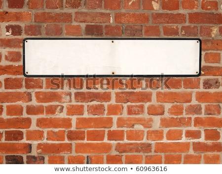 белый британский улице подписать красный кирпичная стена стены Сток-фото © latent
