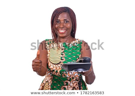 Good looking woman holding and showing her phone while standing against a white background Stock photo © wavebreak_media