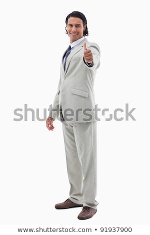 Retrato oficinista posando pulgar hasta blanco Foto stock © wavebreak_media