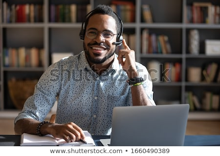 professional receptionist smiling with earphone stock photo © pablocalvog